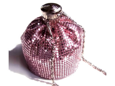 A small bottle is totally wrapped by pink scale mesh curtain.
