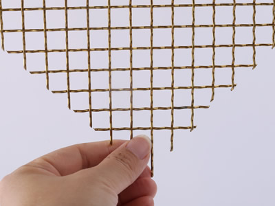 This piece of woven wire drapery sample is woven by brass.