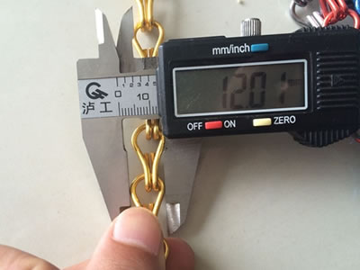 Measuring the hook width of chin link curtain, it's about 12.01 mm.