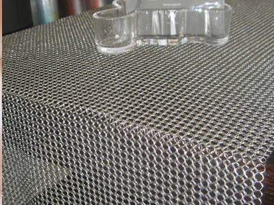 Detail about chainmail curtain used for table.