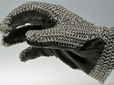 A chainmail glove, its front is leather and its back is chainmail.