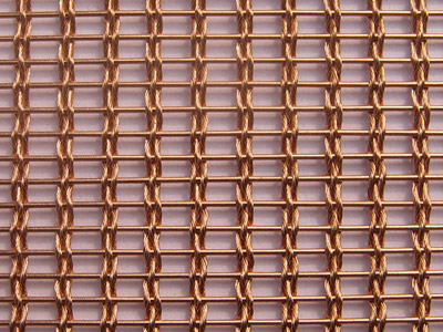 An enlarge view of woven wire drapery in copper color, and it is woven by three strand wire rope and copper rods.