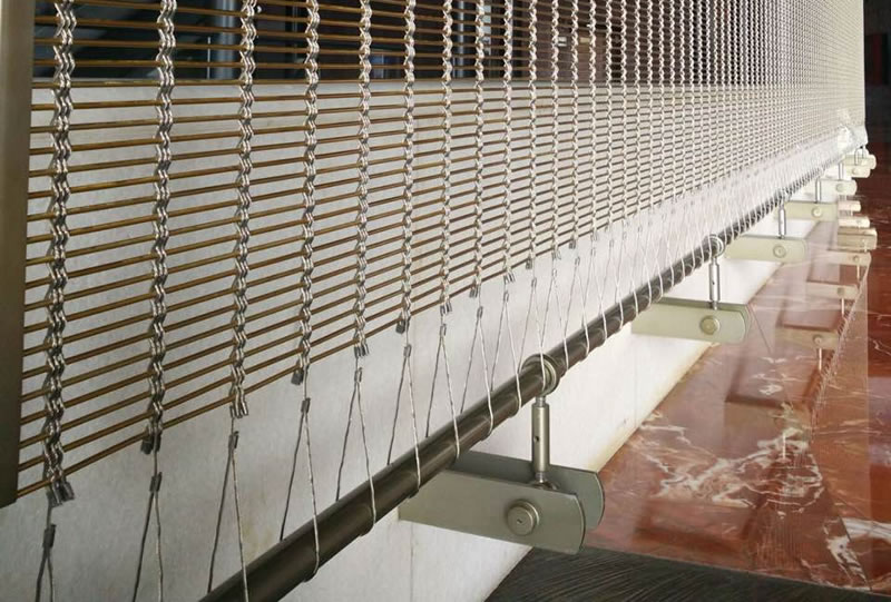 Details about woven wire curtain, it is woven by five strand wire rope and copper rods.