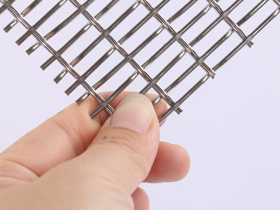 A piece of woven wire drapery sample that is woven by double vertical wire.