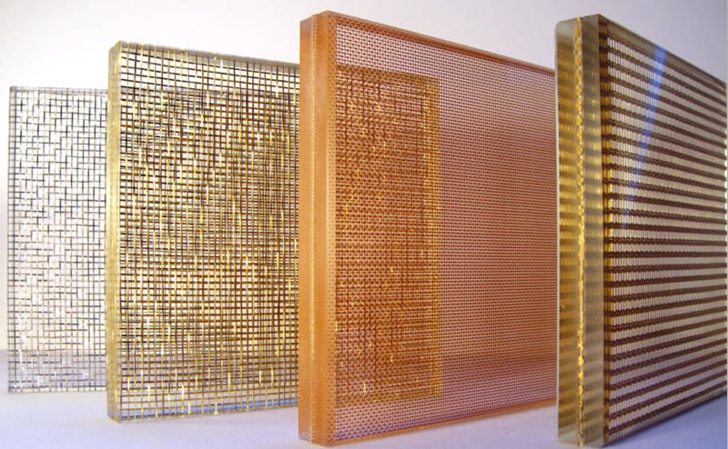 Four different types of woven wire mesh laminated glass standing on the table.