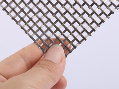 The back side of this sample is woven by flat steel wire.