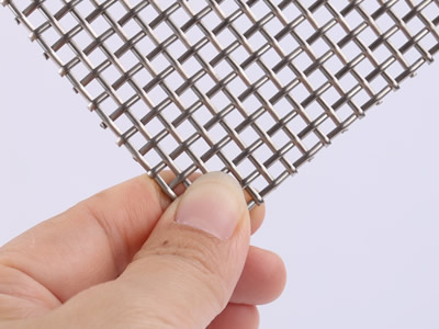 The front side of this sample is woven by half round steel wire.
