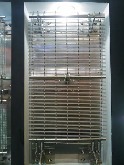 Hang the woven wire curtains directly on the stainless steel rod.