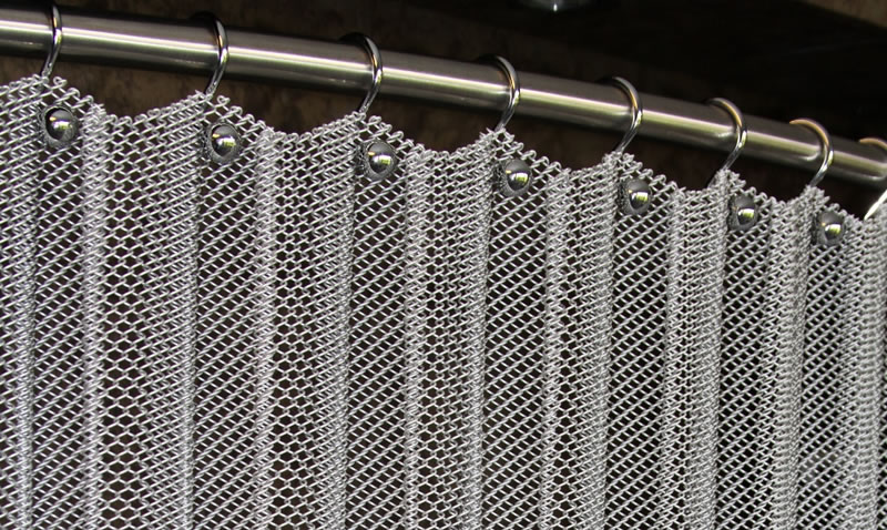 Metal Coil Curtain On The Stainless Steel Rod Fixed With Rings And Screws