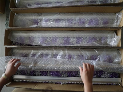 Colorful chain link curtain and curtain track are packaging in a carton and covered with bubble bag, three cartons are beside it.