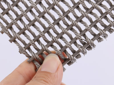 This piece of woven wire drapery sample is woven by stainless steel rods and one strand stainless steel wire rope.