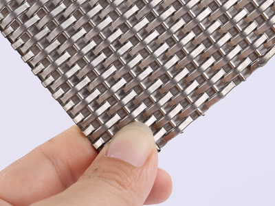 The front side of woven wire drapery made of thick round wire.