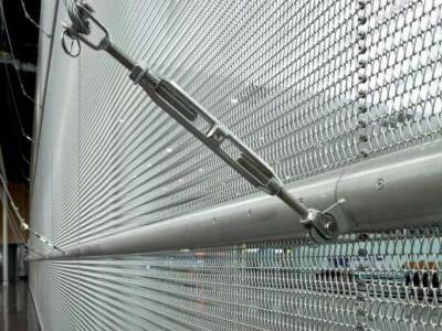 Wire mesh belt as wall cladding material, and a metal chain connects to iron pillars that on the wire mesh belt.