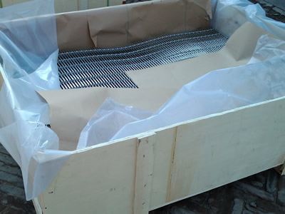 Woven wire curtain is put in a wooden case that covers with water proof paper and plastic film inside.