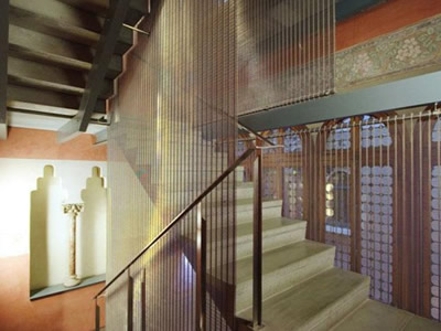 Woven wire curtain decorates the whole stairs with a good drooping.