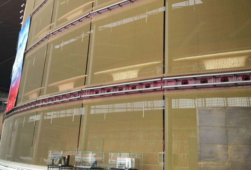 Woven wire curtain as exterior wall decoration covers the whole building.