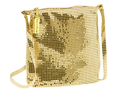 The surface of a knapsack is made of yellow scale mesh curtain.